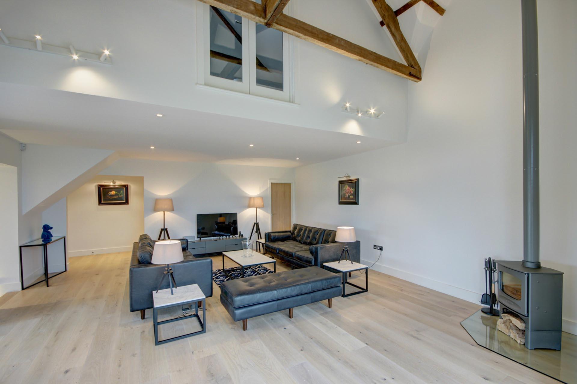 black sofas in barn conversion